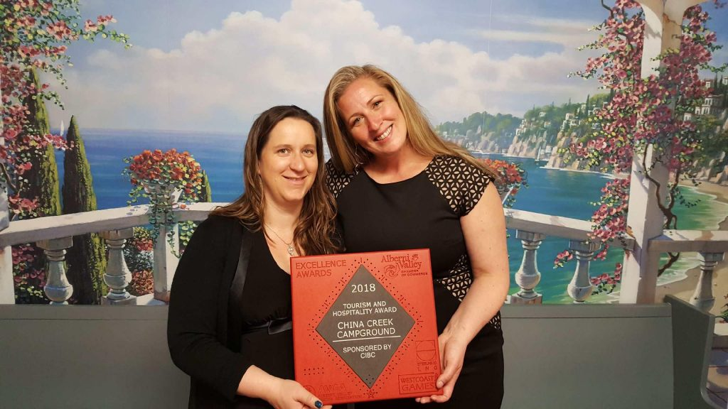 Cecilia Addy and Jen Bortolotto accepting China Creek Campground's Alberni Valley Chamber of Commerce Excellence Award for Tourism and Hospitality